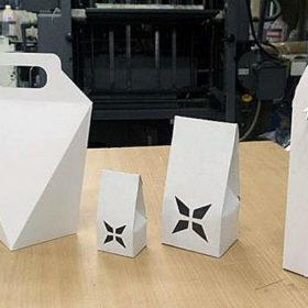 Изготовление упаковки из белого картона с вырубкой узорных отверстий